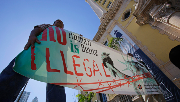 Immigration reform activists hold a sign in front of Freedom Tower in downtown Miami, Monday, January 28, 2013.