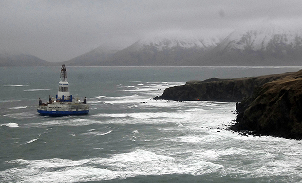 This image provided by the U.S. Coast Guard shows the Royal Dutch Shell drilling rig Kulluk aground off a small island near Kodiak Island, Wednesday, January 2, 2013.