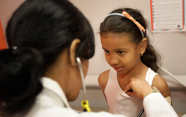 Brianny Abreu, 6, has her vitals checked at the William F. Ryan Community Health Center in New York, Wednesday, June 27, 2012.