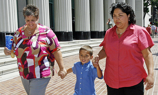 Guadalupe Benitez, right, walks with her partner Joanne Clark, left, and their son Gabriel Clark-Benitez, center, after a news conference held at the Hall of Justice in downtown San Diego, Monday, August 18, 2008. The California Supreme Court ruled that Benitez, a lesbian, was unfairly denied a common infertility treatment  by doctors at the North Coast Women's Care Medical Group based on their religious beliefs.