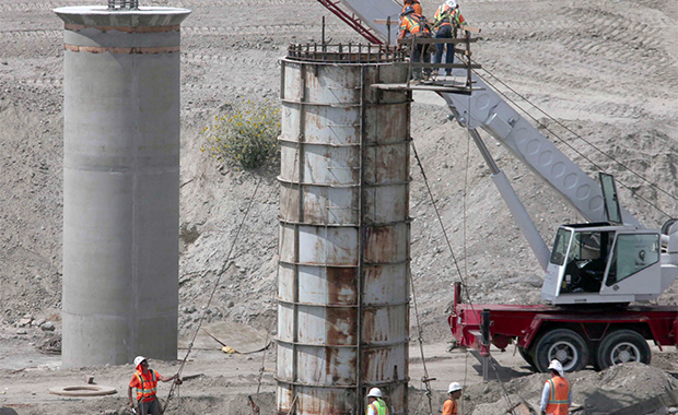 In this September 14, 2009, file photo, road workers begin construction along California Interstate 215 north in San Bernadino County.