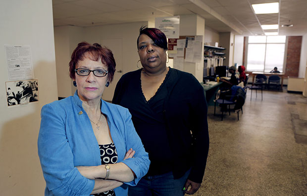 Evelyn Craig, left, executive director of reStart Inc., and LaTonya Jenkins, a reStart client who lives at the facility, pose at the homeless shelter in Kansas City, Missouri, March 19, 2013. The women are concerned that Missouri's refusal to expand Medicaid under the Affordable Care Act will harm residents of the shelter such as Jenkins.