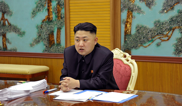 In this undated photo released by the Korean Central News Agency and distributed Sunday, January 27, 2013, in Tokyo by the Korea News Service, North Korean leader Kim Jong-un attends a consultative meeting with officials in the fields of state security and foreign affairs at an undisclosed location in North Korea.