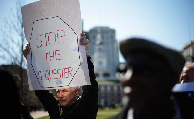 Government workers, supporting union members and activists, protest against the across-the-board federal spending cuts called sequestration at Independence National Historical Park, Wednesday, March 20, 2013, in Philadelphia.