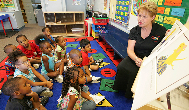 Preschool teacher Cheryl Schmidt, right, reads Mouse Paint to her preschool children at Bellwood Discovery School in Murfreesboro, Tennessee.