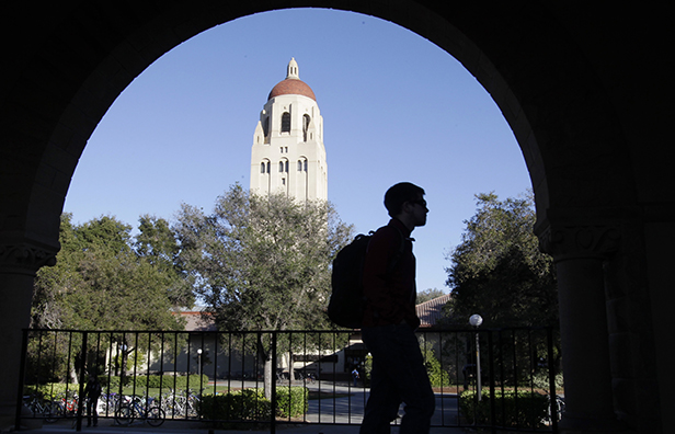 A Stanford University student walks in front of Hoover Tower on the Stanford University campus in Palo Alto, California, February 15, 2012. The rise in student-loan debt could have a negative impact on the housing market, the broader economy, and Americans' future financial security.