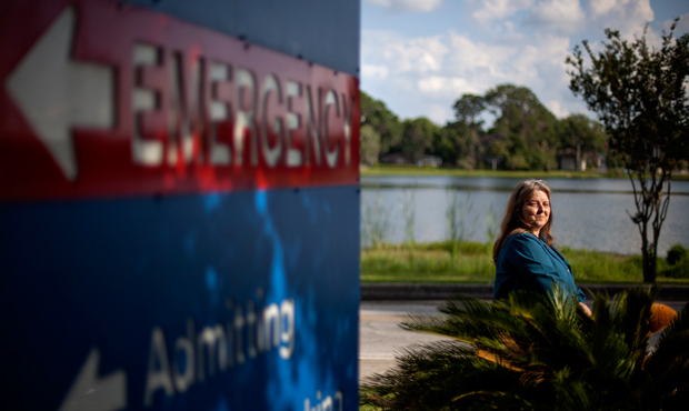 Kathleen Watson is photographed outside Shands Lake Shore Hospital, where she receives her cancer treatment and also picks up patients for her medical transport company, Monday, May 14, 2012, in Lake City, Florida.