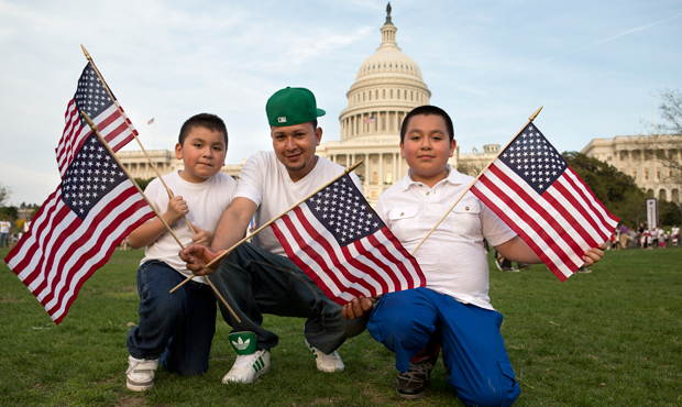 "Josue Benavides, 28, center, who is originally from El Salvador, poses for a portrait with his cousins, Jonathan, 7, left, and Christopher Benavides, 11, of Alexandria, Virginia, after attending the ""Rally for Citizenship,"" a rally in support of immigration reform on Capitol Hill in Washington, Wednesday, April 10, 2013."