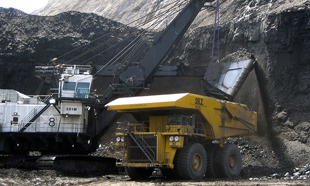 A shovel prepares to dump a load of coal into a 320-ton truck at the Black Thunder Mine, located within Wyoming's Powder River Basin, the nation'€™s most productive coal region.