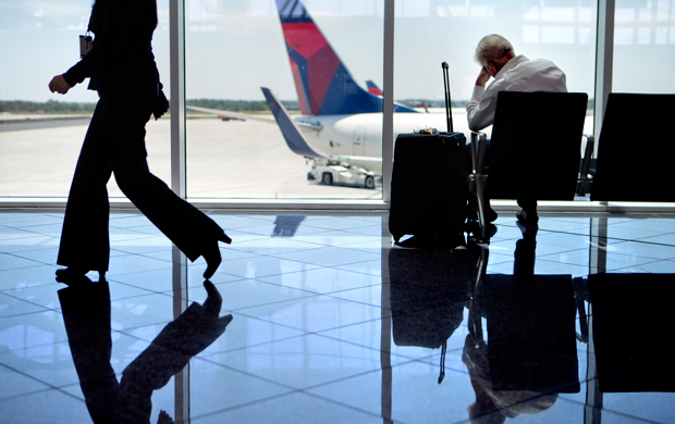 A passenger sits in the international terminal at Hartsfield-Jackson Atlanta International Airport, Friday, April 26, 2013.