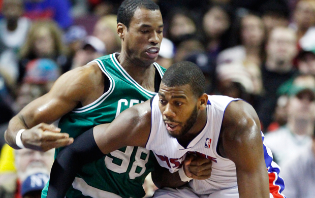Then-Boston Celtics center Jason Collins, left, guards Detroit Pistons center Greg Monroe, right, in the second half of an NBA game in Auburn Hills, Michigan.