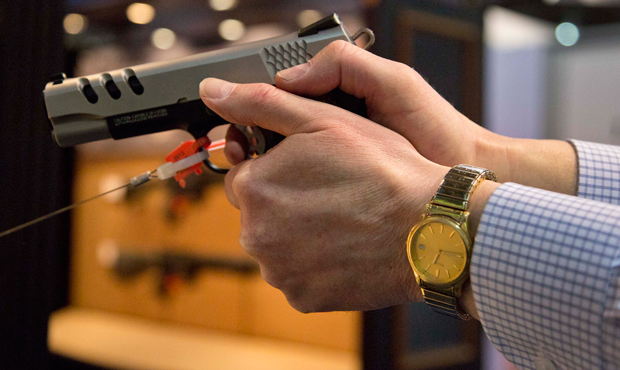 The Smith & Wesson .45 caliber M1911 pistol is held at the 35th annual SHOT Show, Tuesday, January 15, 2013, in Las Vegas.