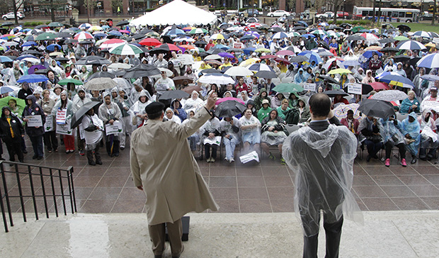 Demonstrators gather outside the Ohio Statehouse during a rally urging state lawmakers to extend Medicaid coverage under the Affordable Care Act, Thursday, April 11, 2013, in Columbus, Ohio.