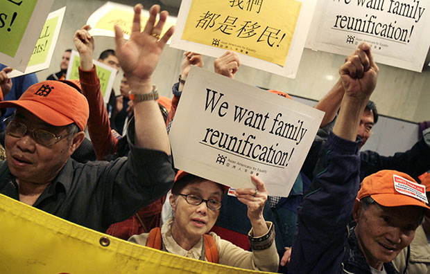 A group of Asian Americans joins others that support reform of immigration legislation at a rally in New York, Tuesday, May 1, 2007.