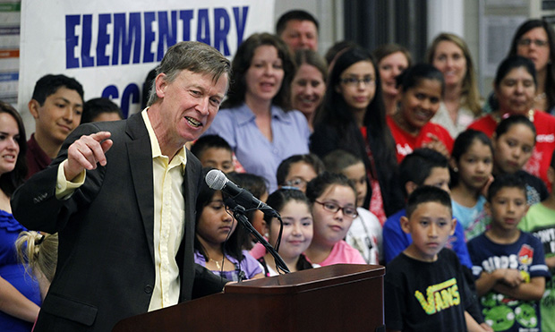 Colorado Gov. John Hickenlooper (D) speaks to a gathering of primary school students, teachers, and administrators at Rose Hill Elementary, in Commerce City, Colorado, Wednesday, May 15, 2013.