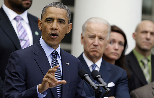 President Barack Obama, next to Vice President Joe Biden, gestures as he speaks during a news conference in the Rose Garden of the White House, Wednesday, April 17, 2013, about the defeat in the Senate of a bill to expand background checks on guns. There is much the president can do without congressional approval to address gun violence.