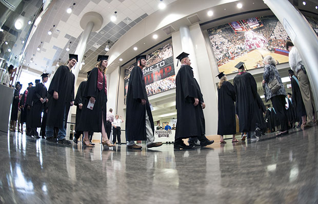 Graduates enter Mississippi State University's Humphrey Coliseum on Saturday, May 11, 2013. Sequestration is making it difficult for many students, particularly those from low-income families, to afford a college education in the United States.