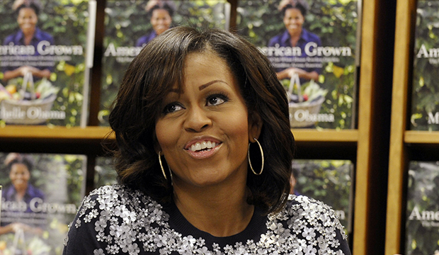 First Lady Michelle Obama signs copies of her book <i>American Grown: The Story of the White House Kitchen Garden and Gardens Across America</i> at the Politics & Prose bookstore in Washington, Tuesday, May 7, 2013.