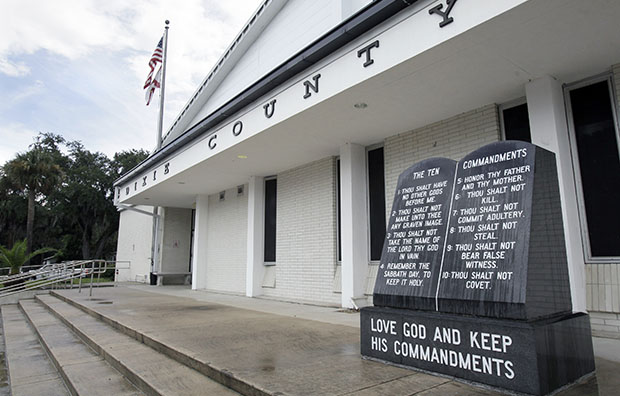 The Ten Commandments monument is seen in front of the Dixie County Courthouse in Cross City, Florida, July 27, 2011.