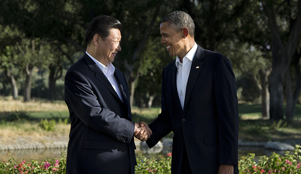 President Barack Obama shakes hands with Chinese President Xi Jinping at the Annenberg Retreat at Sunnylands as they meet for talks Friday, June 7, 2013, in Rancho Mirage, California.