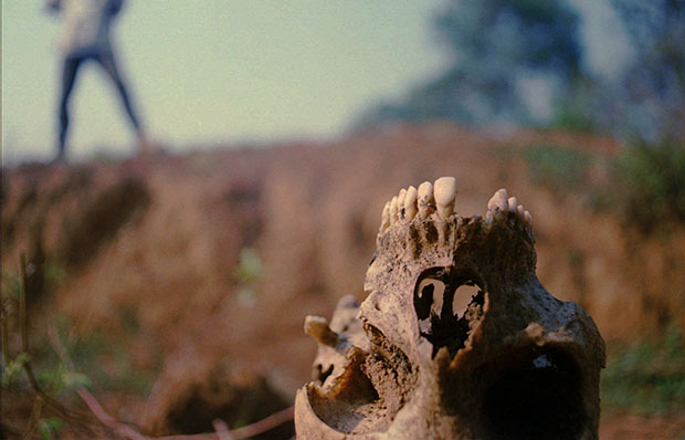 A skull lies near the bottom of a recently excavated mass grave at the site of the 1994 Nyamata, Rwanda, Roman Catholic Church massacre, Wednesday, August 6, 1997.