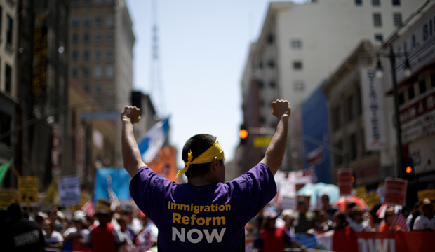 Marchers walk along during a rally for immigration reform in downtown Los Angeles, Wednesday, May 1, 2013.