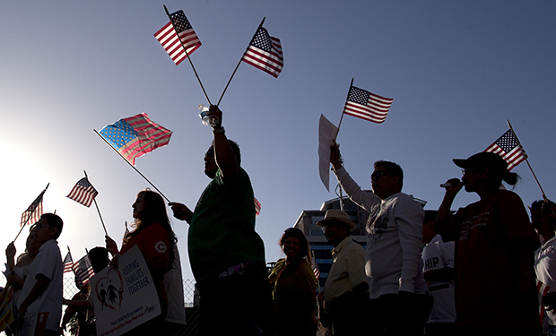 Demonstrators march down Las Vegas Boulevard during an immigration rally, Wednesday, May 1, 2013, in Las Vegas.