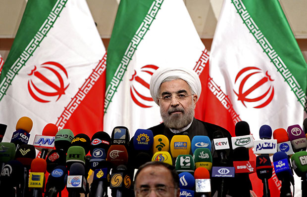 Newly elected Iranian President Hassan Rowhani listens during a press conference in Tehran, Iran, Monday, June 17, 2013.