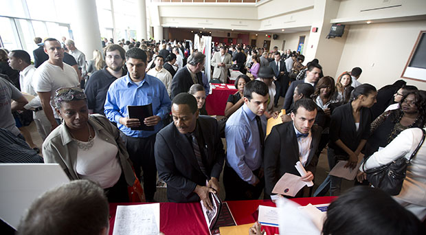 Job seekers fill a room at the job fair in Sunrise, Florida, January 22, 2013. Economic growth and labor-market growth are still too slow to make a difference for the middle class.