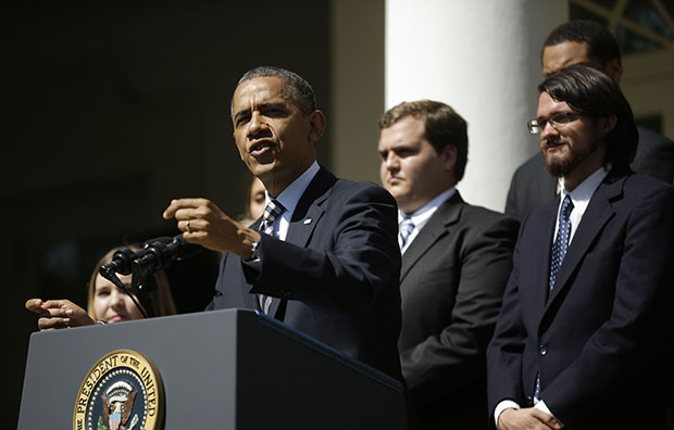 President Barack Obama, joined by college students, speaks in the Rose Garden of the White House in Washington, Friday, May 31, 2013, where he called on Congress to keep federally subsidized student-loan rates from doubling on July 1.