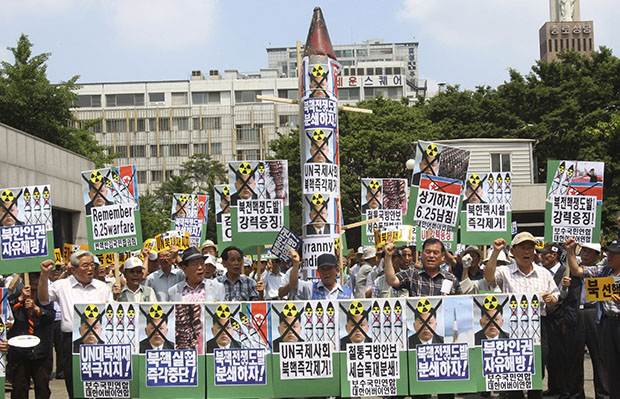 South Korean protesters gather with a mock North Korean rocket, center, and defaced portraits of North Korean leader Kim Jong-un during a rally against North Korea ahead of the 63rd anniversary of the outbreak of the Korean War in Seoul, South Korea, Monday, June 24, 2013.