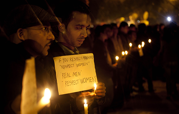 Indians participate in a candle-lit vigil to mourn the death of a gang rape victim in New Delhi, India, Sunday, December 30, 2012.