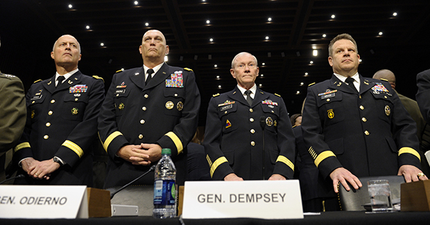 From left, Judge Advocate General of the Army Lt. Gen. Dana Chipman; Army Chief of Staff Gen. Ray Odierno; Joint Chiefs Chairman Gen. Martin Dempsey; and Legal Counsel to the Chairman of the Joint Chiefs of Staff Brig. Gen. Richard Gross, arrive on Capitol Hill in Washington, Tuesday, June 4, 2013, to testify before the Senate Armed Services Committee hearing on pending legislation regarding sexual assaults in the military.
