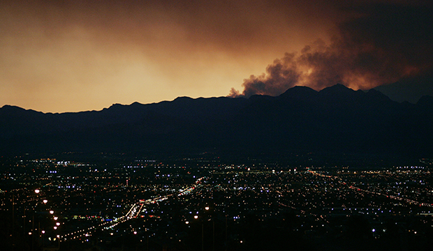 Smoke from the Mount Charleston wildfires hovers over the Las Vegas valley shortly after sunset, Tuesday, July 9, 2013.