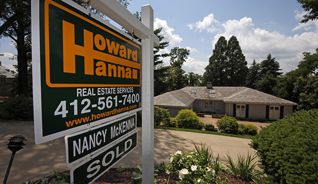 A home is sold in Mt. Lebanon, Pennsylvania, Tuesday, July 23, 2013.