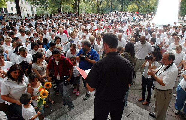 Participants bow their heads in prayer during a demonstration to protest Alabama's new law against illegal immigration in Birmingham, Alabama, June 25, 2011.