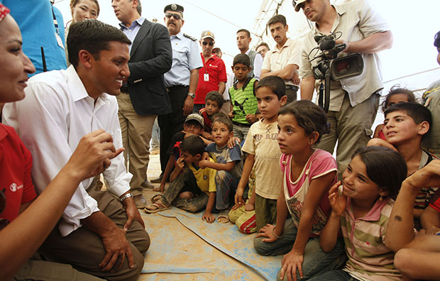 Rajiv Shah, second from left, the head of the U.S. Agency for International Development, or USAID, speaks to Syrian refugee children in one of the UNICEF tents at Zaatari Refugee Camp in Mafraq, Jordan, September 5, 2012.