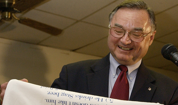 "Republican Judge Lloyd A. Karmeier smiles as he reads from a t-shirt, ""Top Ten Reasons I Voted For Judge Karmeier,"" after defeating Democrat Gordon E. Maag for a seat on the Illinois Supreme Court, Tuesday, November 2, 2004, during an election night gathering at the American Legion Hall in Nashville, Illinois."