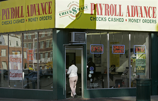 A customer enters a Payroll Advance location, Thursday, November 6, 2008, in Cincinnati, Ohio.