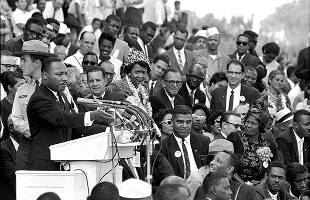 "Dr. Martin Luther King Jr., head of the Southern Christian Leadership Conference, speaks to thousands of people during his ""I Have a Dream"" speech in front of the Lincoln Memorial for the March on Washington for Jobs and Freedom, in Washington, August 28, 1963. Actor-singer Sammy Davis Jr. is at the bottom right."