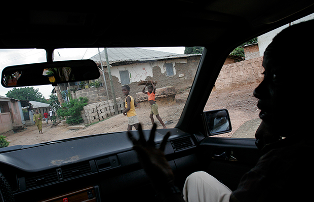 An undercover officer working on drug-related cases for the judicial police speaks with journalists in a car in Bissau, Guinea-Bissau, July 16, 2007.
