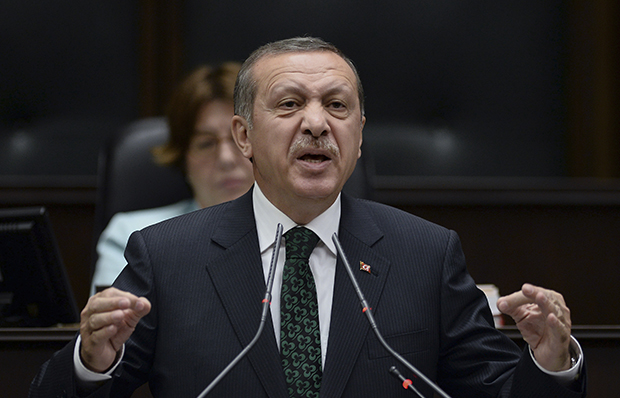 Turkey's Prime Minister Recep Tayyip Erdoğan addresses lawmakers and supporters of his ruling Justice and Development Party at the parliament in Ankara, Turkey, Tuesday, June 11, 2013.