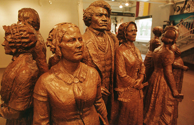 Shown in a June 2, 1995, photo, a group of life-size bronze statues is the iconic, signature piece of art at the Women's Rights National Historical Park in Seneca Falls, New York. The statues depict Elizabeth Cady Stanton, Frederick Douglass, Lucretia Mott, and other attendees at the Seneca Falls Convention of 1848.