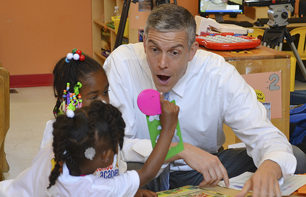 U.S. Secretary of Education Arne Duncan visits with young students at the St. Benedict Center for Early Childhood Education in Louisville, Kentucky, Thursday, June 20, 2013.