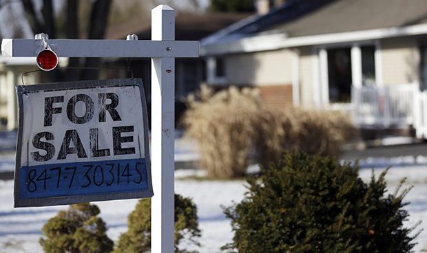 "A ""for sale"" sign is seen outside a home in Glenview, Illinois."