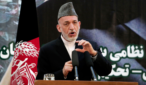 Afghan President Hamid Karzai speaks at a press conference during a ceremony at a military academy on the outskirts of Kabul, Afghanistan, Tuesday, June 18, 2013.