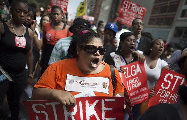 Demonstrators in support of fast-food workers march toward a McDonald's, Monday, July 29, 2013, in New York's Union Square. They are demanding higher wages and the right to form a union without retaliation.