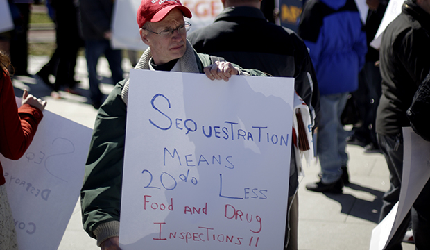 Government workers supporting union members and activists protest against the across-the-board federal spending cuts known as sequestration at Independence National Historical Park in Philadelphia.