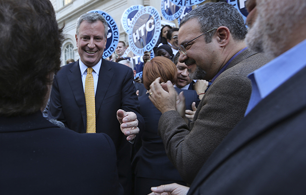 Democratic mayoral hopeful Bill de Blasio greets supporters after a news conference, Tuesday, September 17, 2013, on the steps of City Hall in New York.