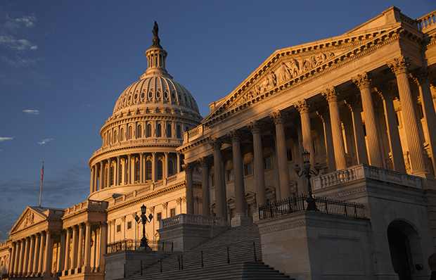 The morning sun illuminates the U.S. Capitol in Washington, Monday, September 30, 2013, as the government teeters on the brink of a partial shutdown at midnight unless Congress can reach an agreement on funding.